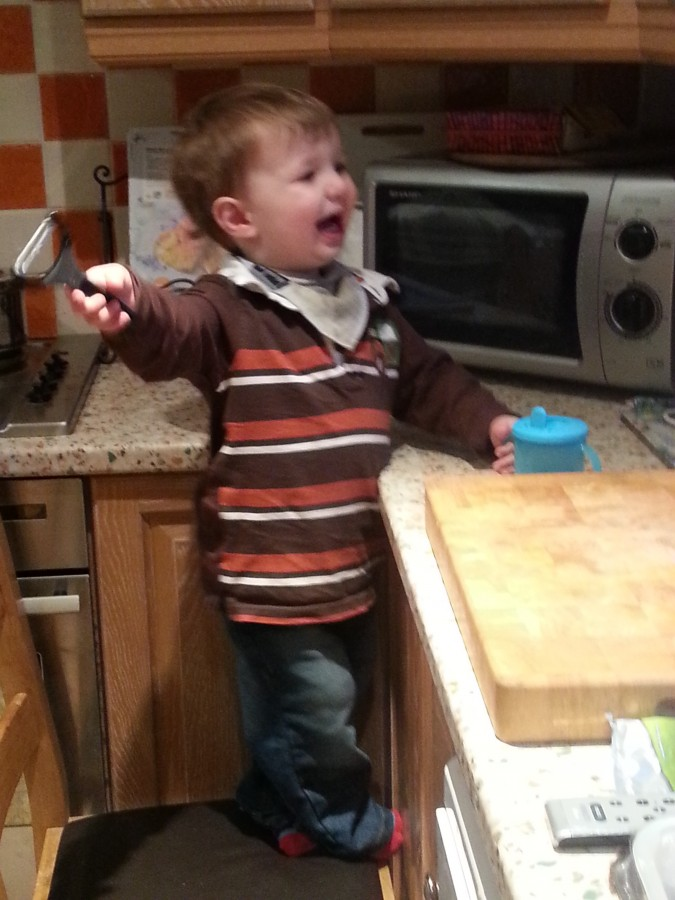 Toddler helping with cooking
